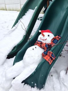 snowman playing on the slide.