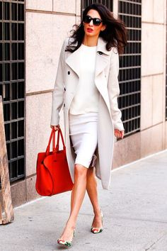 What Amal Clooney Wore To Her New Teaching Job #refinery29 http://www.refinery29.com/2015/04/85090/amal-clooney-spring-coat-outfit#slide-1 Amal Clooney was photographed at Columbia University in a white pencil skirt, matching top, and punchy patterned heels.
