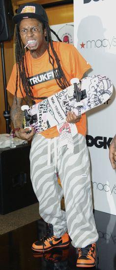 Lil Wayne looks like a monstrous little imp.