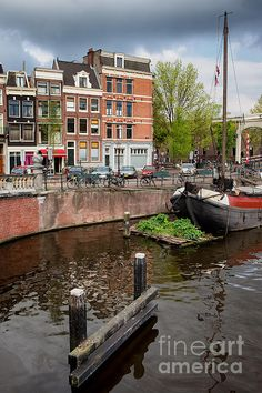 City of Amsterdam in Holland, Netherlands, Amstel river picturesque waterfront.