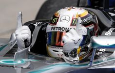 Mercedes driver Lewis Hamilton of Britain gestures in his car after winning the Malaysian Formula One Grand Prix