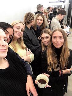 Olsens Anonymous Fashion Blog Mary Kate And Ashley Olsen Twins Style New York Fashion Week The Row Instagram Spottings Friends All Black Look photo Olsens-Anonymous-Fashion-Blog-Mary-Kate-And-Ashley-Olsen-Twins-Style-New-York-Fashion-Week-The-Row-Instagram-Spottings-All-Black-Long-Wavy-Hair-Oversized-Coat-Blazer-Turtleneck-Sweater.jpg
