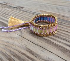 NEW: limited edition OOAK beautiful beaded woven bracelet with big golden tassel, framed with gold plated heavy chain
