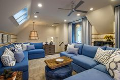 """""""The great thing about this space is that the two sectionals can configure into different arrangements,"""" explains design coordinator Kelly Mockingbird. """"You can move them around and make a huge palette facing the sofa, so it's a really fun space. Blue Sectional, Sectional Sofas, Blue Couches, Hgtv Dream Homes, Smart Home Design, Living Spaces, Living Room, Cheap Home Decor, Home Furniture"""