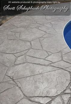 Stamped concrete patio. Less expensive than flagstone.