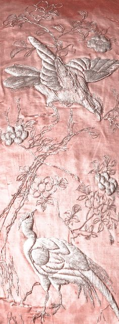 This Pink Satin is embroidered with Silver Thread to emphasize its color and add texture. Adds more detail to whatever is chosen to make out of it.  - Israa Dief (FASN 1100)