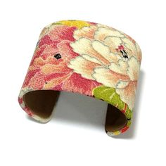 Kimono Cuff Tokyo Pink, $52, on Fab, 6/17/13, by Maiko Girl.  Maiko Girl transforms Japanese kimono fabric into stunning, outfit-making cuffs. The vibrant fabric wraps around a leather-lined metal base for a comfortable, adjustable finish.