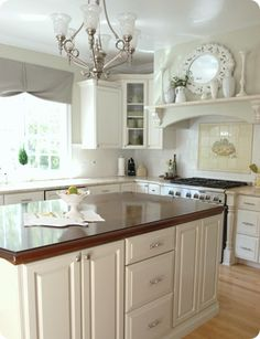 kitchen island painted  I painted the island, a gray green color by Benjamin Moore called 'Camouflage'.