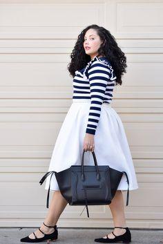 Girl With Curves blogger Tanesha Awasthi wears a stripe ruffle sweater, midi skirt, strappy flats and Celine Phantom bag.