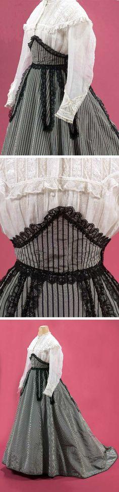 Blouse, belt, & skirt ensemble, 1866. Gray taffeta with black stripes, braid, & lace. One pocket. Flat front, pleated in back. Boned blouse bordered with lace du Puy and black bugle beads. Musée Galliera, Musée de la Mode de la Ville de Paris