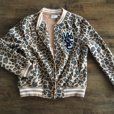 WESC Cheetah Varsity Jacket Great fleece lined WESC cheetah print varsity jacket. Worn twice. Great condition! WESC Jackets & Coats