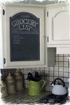 Love this idea. Chalkboard paint on cabinet