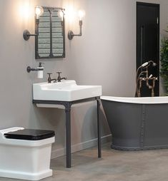 The Brunel collection from Aston Matthews includes the Brunel cast iron bath, Brunel industrial style accessories and wall lights, matching mirror and basin stand. Shown here with the Metro sink and Metro WC