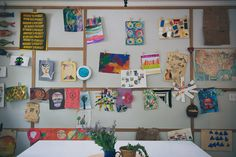 Kid's art display wall in the dining room! DIY