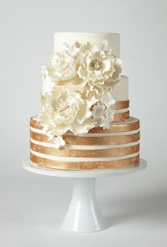 Brides: America's Prettiest Wedding Cakes | A Glamorous Ivory Cake with Copper Stripes and Flowers | Cake by Coco Paloma Desserts