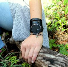 Stylish black leather wrap with a black Cuckoo Nest Art Studio minimalist watch face. The leather strap will wrap around your wrist multiple times and a buckle provides closure.