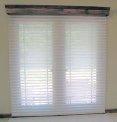 "Motorized ""Window Shadings"" from Kathy Ireland Home by Alta. The motor is housed in the handmade wood cornice above the French Door."