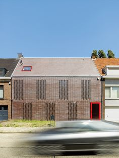 """The facade of a house in Belgium consists of """"knitted bricks.""""  """"In this part of Belgium, 90 percent of the houses are built with brick,"""" says architect Tom Verschueren. """"It's a classic material that we tried to use in House BVA in a totally different way."""""""