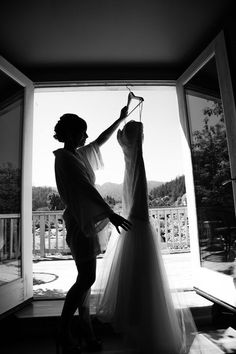 Wedding Inspiration | Wedding Photography I like that she's holding the dress, not just the dress alone