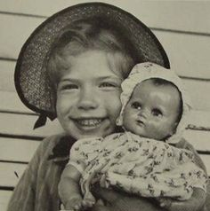 Theriault's top 15 favorite photographs of notable women, historical figures, and celebrities, joyfully posing with their favorite dolls and toys. #2 Young Carly Simon with her beaming smile showing off her adored doll.