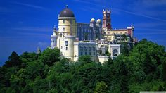 Pena National Palace- Portugal This palace sits atop a mountain outside Sitra, and on a clear day, can be seen from as far as Lisbon. It was used as a monastery during the 15th century, before...