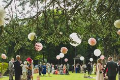 Guests enjoying their hand-packed picnic hampers, sandwiches and champagne on the lawns at Thornbridge Hall celebrating Rebecca & Calum's wedding  Photography by Tobiah & Laura Tayo www.tobiahtayo.com