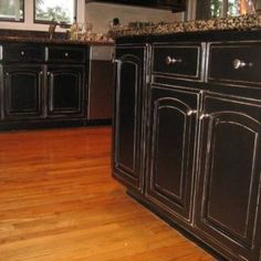 Black cabinets with faux distressing. Used 3 different colors of ...