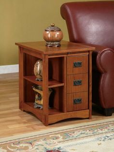 """Powell Furniture Multi Functional Wooden End Table by Powell Furniture. $189.99. Features a wipe-clean surface pull-out shelf for beverages and snacks.. Provides function and style to any room in your home.. Features concealed storage and open storage.. Some assembly required.. """"Mission Oak"""" finish. This functional table is perfect to keep everything within arms reach beside a recliner, sofa, or bed. The front features concealed storage on one side behind a door with faux dra..."""