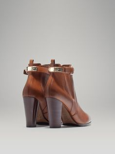 HIGH HEELED LEATHER STRETCH ANKLE BOOT