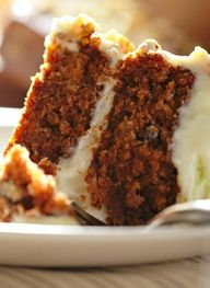 Ultimate Carrot Cake Cake 1/2 cup vegetable oil 1/2 cup orange juice 1 (8 oz can crushed pineapple undrained 1 tsp. graded orange peel 1 tsp. vanilla 4 eggs 1/2 cup coconut 1/2 cup finely chopped n...