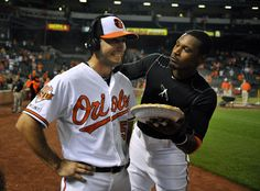 Orioles right-hander Miguel Gonzalez, left, receives a pie in the face by center fielder Adam Jones after pitching a shutout against the Cincinnati Reds at Camden Yards.