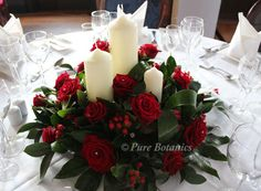 large red roses wedding church arrangements | red-rose-top-table-centrepiece