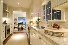 kitchens - galley kitchen white cabinets white carrara marble countertops Klismos chairs Beautiful creamy white galley kitchen design with creamy White Kitchen, Kitchen Design Decor, Transitional Kitchen, White Galley Kitchens, Kitchen Decor, White Kitchen Cabinets, Kitchen Dining Room, Home Kitchens, Gorgeous White Kitchen