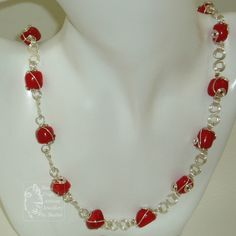 Deep Red Coral Nugget beads wire wrapped and joined together with Silver plated copper wire swirly links. £30.00