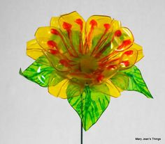 Upcycled Yellow and Orange Fun Flower Made of Plastic Water Bottles Plastic Bottle Flowers, Plastic Bottle Crafts, Plastic Art, Recycle Plastic Bottles, Recycled Bottles, Recycled Crafts, Diy Crafts, Diy Projects To Try, Craft Projects