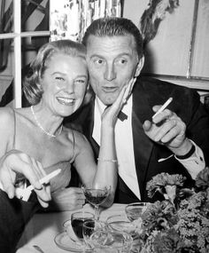 June Allyson and Kirk Douglas enjoy the evening