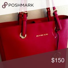 michael kors jet set travel tote michael kors. large jet set travel tote. red saffiano leather. wear on the handles, otherwise great condition. fits a large laptop. interior compartments. gold hardware. Michael Kors Bags Totes