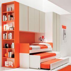 triple bunk bed saving space with bookshelf