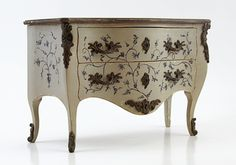 French Louis XV chest. XVIII Century Deeply decorated with painted flowers. Drawers with dovetail assemblies. Fittings made of bronze and aged marbled countertop.
