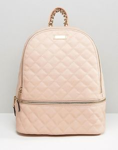 Quilted backpack in blush by ALDO. Backpack by ALDO Faux leather outer Quilted finish Fully lined Adjustable straps Zip top closure External pockets Int...
