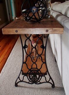 Sofa table using the legs from the old sewing machine with the bad cabinet.  Instructions on board widths, etc at http://stephsnewagain.blogspot.com/2014/07/singer-sewing-machine-sofa-table.html