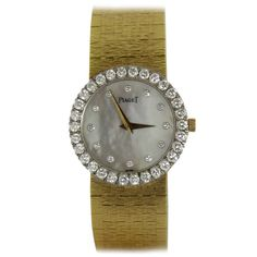 Piaget Lady's Yellow Gold and Diamond Bracelet Watch with Mother of Pearl Dial | From a unique collection of vintage wrist watches at https://www.1stdibs.com/jewelry/watches/wrist-watches/