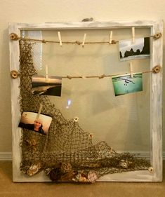Shabby Beach themed 1940's barn glass window pane. Nautical theme. Net with sea shell decor and old fishing rope for hanging beach photos.