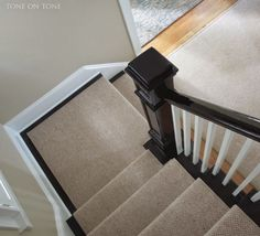 Tone on Tone: A Living Room Project a wool sisal style staircase runner with v. Tone on Tone: A Living Room Project a wool sisal style staircase runner with very narrow binding. Dark Staircase, Black Stairs, Staircase Runner, Staircase Design, Black Railing, Stair Runners, Painted Banister, Banisters, Stair Railing