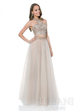Two piece prom dress with a sequin embellished halter crop top. This prom gown is paired with a full, A-line mesh skirt.