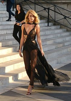 Rosie Huntington-Whiteley at Atelier Versace. See all the celebs at Paris Couture Week.