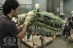 Master Character Painter and Special Effects Artist Christopher Swift paints reptilian details on one of Stan Winston Studio's animatronic Zorgon heads from Jon Favreau's ZATHURA.