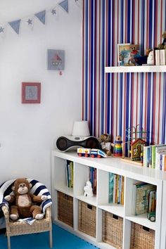 Ikea Expedit book shelf.  Perfect for a toddler to store toys AND books.  When they are older just stand it up!