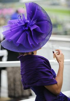 A racegoer wearing a large purple hat awaits the start of a race during Ladies Day at the Epsom Derby Festival on June 2009 in Epsom, England. Purple Love, Purple Lilac, All Things Purple, Shades Of Purple, Purple Stuff, Periwinkle, Color Lila, Colour, Red Hat Society