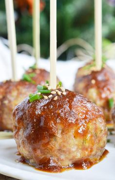 These Saucy Asian Meatballs are perfect for parties! This easy appetizer recipe is a combo of baked meatballs and a sweet ginger sauce that takes just 10 minutes to make!!